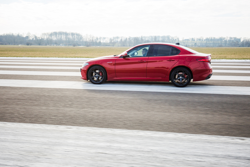 "Red Dot juror Martin Darbyshire tests the car ""Alfa Romeo Giulia"""