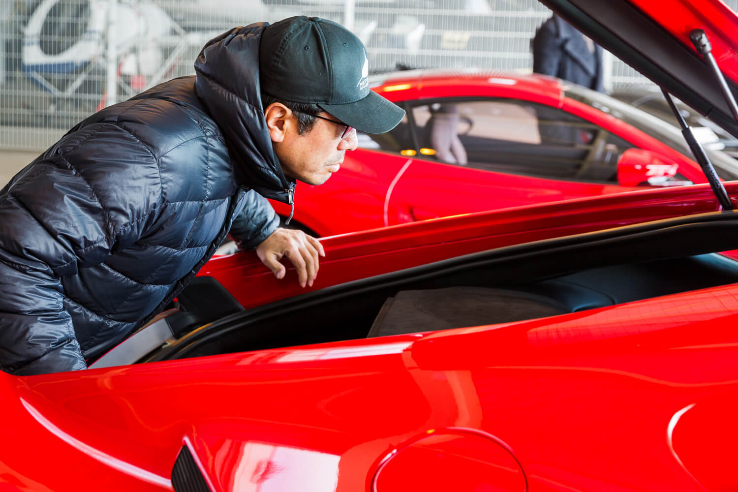 Ken Okuyama tests the trunk of the Ferrari Portofino